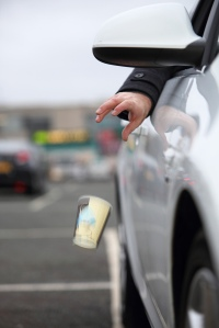 Motorist-dropping-litter-from-a-car
